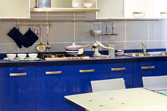 Blue cabinets in a small kitchen