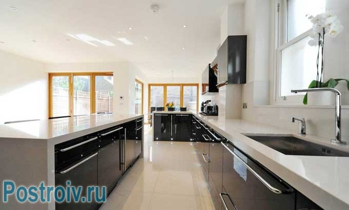 The bright kitchen with a large window .You can make black glossy facades