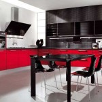 The kitchen is black with red .Photo 11