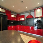 The kitchen is black with red .Photo 13