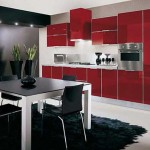 The kitchen is black with red .Photo 15