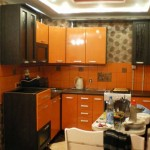 Beautiful idea to design the kitchen in wenge with orange .Photo 9