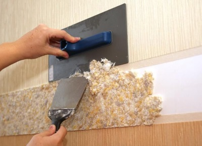 The application of wallpaper on the part of the wall