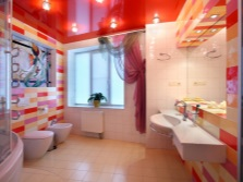 Design red and white tiles in a bathroom with yellow tones