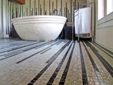 The mosaic floor in the design of the bathroom