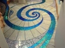 Plus Mosaic tiles on the floor in the bathroom