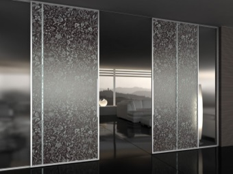Sliding glass doors with two flaps