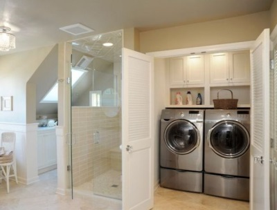 Large closet for the washing machine and dryer in the bathroom