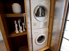 Cabinet made ​​of wood and plastic for a washing machine in the bathroom
