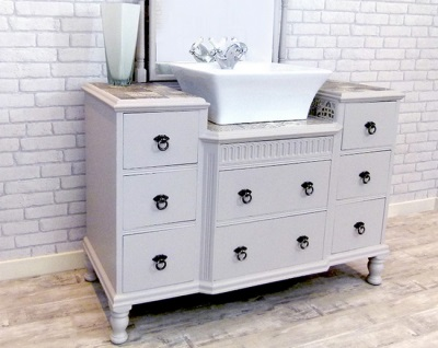 Stand floor white with lots of drawers and overhead washbasin in the bathroom