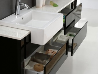 Hinged cabinet in black with a white top and a sink for the bathroom