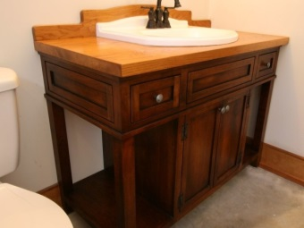 Large floor wooden cabinet with a washbasin in the bathroom