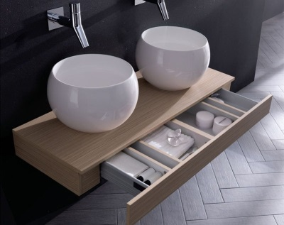A beautiful wooden hanging cabinet with two deep sinks for the bathroom