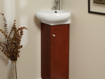 Miniature wooden corner cabinets with washbasin in the bathroom