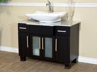 Black MDF cabinet with glass doors and a white sink for the bathroom