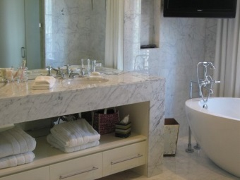 Marble cabinet with wooden drawers with integrated wash basin in the bathroom
