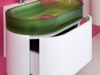 Plastic white semicircular mounted washbasin cabinet with green frosted glass in the bathroom