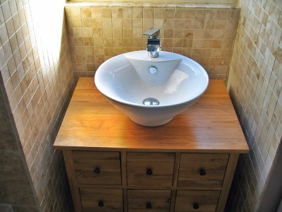 Cupboard with wash basin in the bathroom overhead