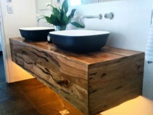 Hanging pedestal of real wood under overhead washbasins