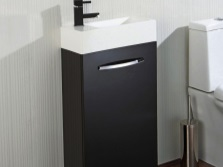 Little black cabinet with a white washbasin