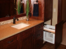 Bathroom furniture - cabinet with sink and a pencil case with laundry basket