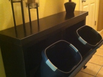 Tumba of black chipboard bathroom with two laundry baskets