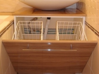 Cabinet with sink and laundry basket
