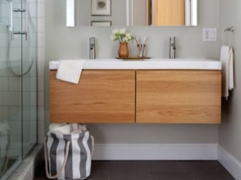 Suspended cabinets with a sink for the bathroom - the advantages