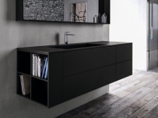 Large hanging cabinet with a sink in the black bathroom