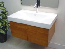 Hanging stand is small in size with a sink for the bathroom