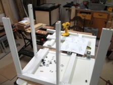 Assembling the suspension cabinets with a sink in the bathroom with their hands