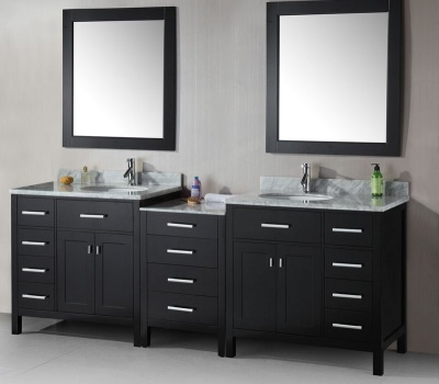 A large black cabinet with two integrated sinks for the bathroom