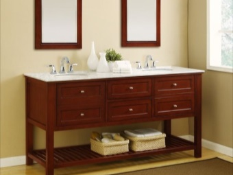 Floor cabinet for the bathroom sinks with built- on wooden legs
