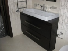 Floor cabinet with built-in sink and plinth