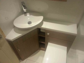 Corner floor pedestal sink with cover for a small bathroom