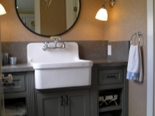 Floor stand on legs with the bathroom sink in a rustic style