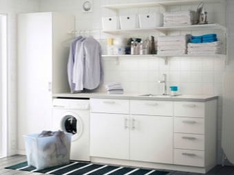 White large cabinet with a sink with an aperture for the washing machine