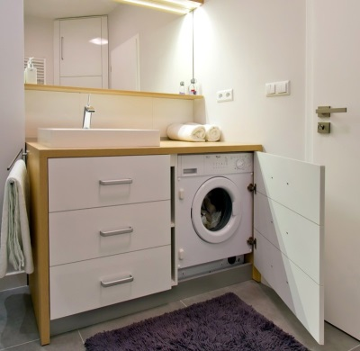 Cabinet with sink and a door for a washing machine