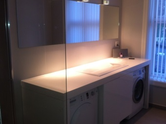 Large cabinet with sink for washing machine and dryer