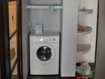 Location of the cabinet for a washing machine in the bathroom