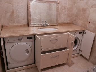 Placing cabinet pedestals for a washing machine in the bathroom