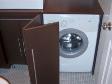 Pros built-in furniture for the bathroom with washing machine