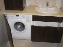 Built-in furniture for a bathroom with washing machine on request
