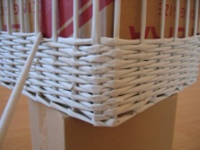Weave rectangular laundry baskets from newspaper tubes