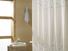 Small picture on white fabric curtain in the bathroom