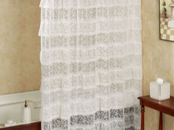 Lace transparent white curtains in the bathroom
