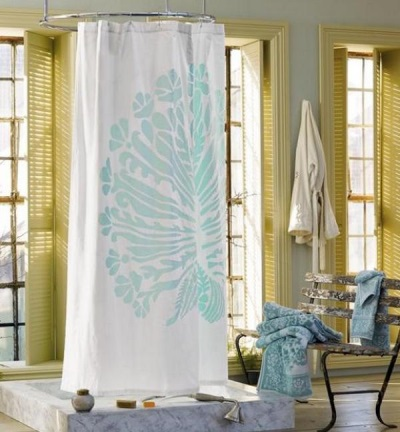 White fabric curtain in the bathroom with a large picture