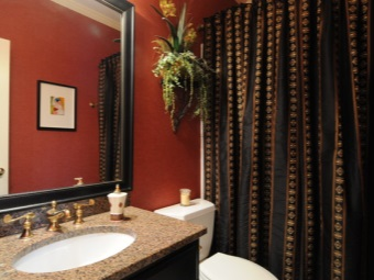 Brown textile curtains in the bathroom - leaving