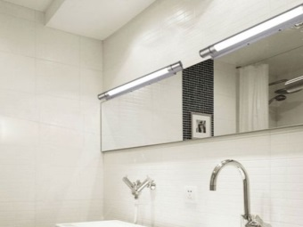 Wall lights in the bathroom with fluorescent lamps