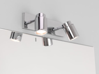 Wall lights in the bathroom with halogen lamps